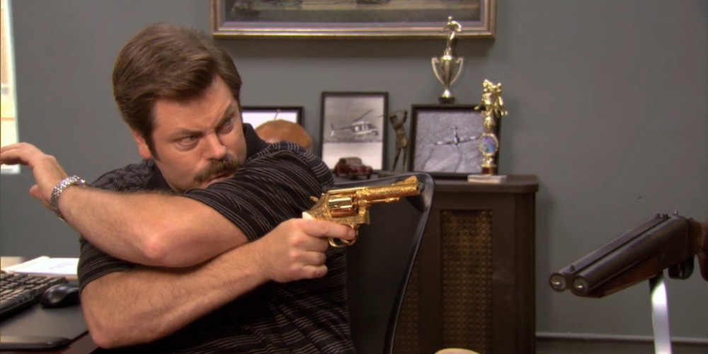 Ron Swanson aiming his gold plated pistol.