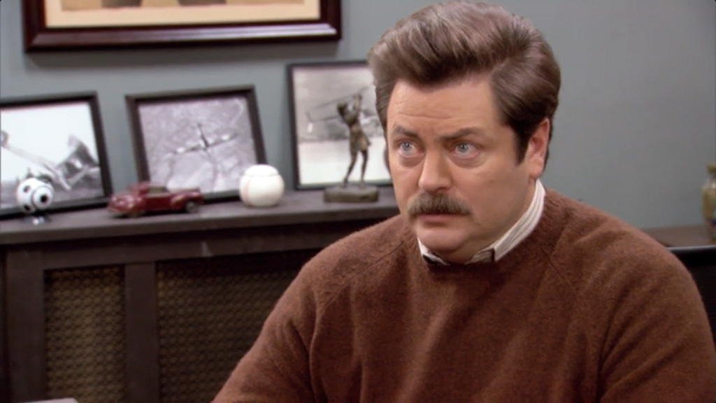 Ron Swanson at his desk.