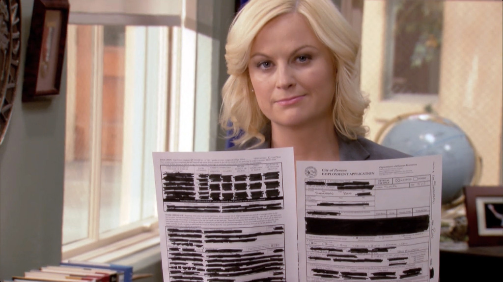 Leslie Knope and one of Ron Swanson's redacted docs.