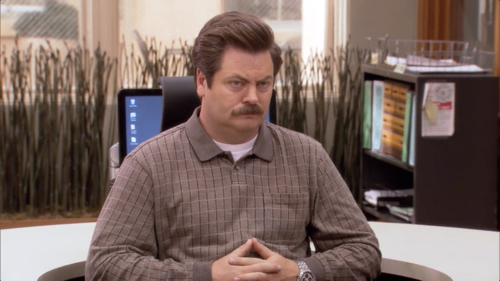 Ron Swanson looking miserable in his government job