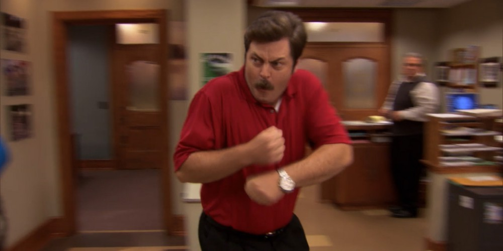 Ron Swanson wearing Tiger Woods red shirt and black pants.