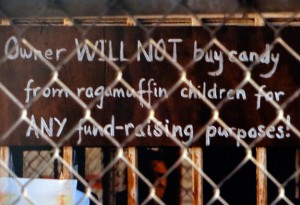 Sign: Owner will not buy candy from ragamuffin children for ANY fundraising purposes!