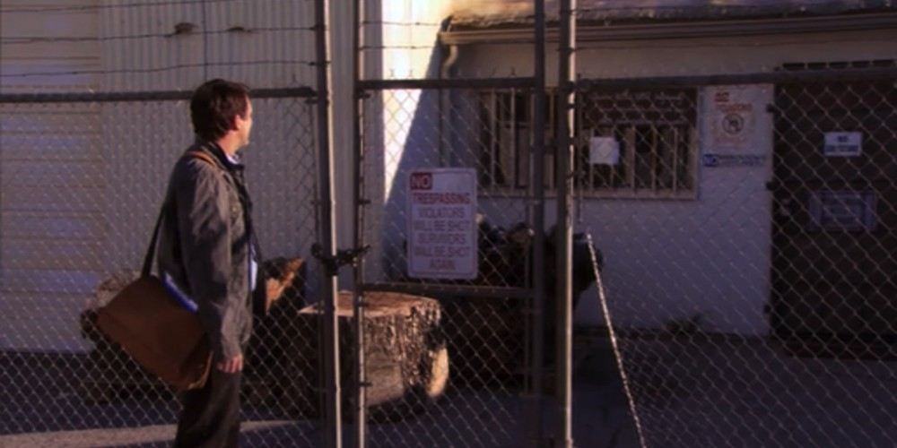 Mark Brendanawicz outside Ron Swanson Swanson's gated wood shop.