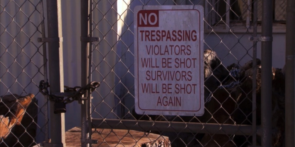 Sign: NO trespassing violators will be shot, survivors will be shot again.