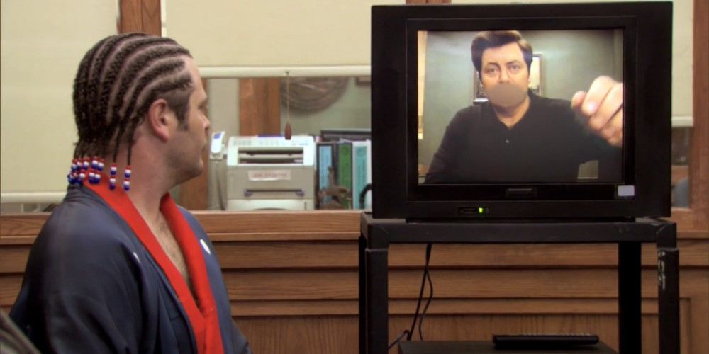 Ron Swanson watching a video message from himself