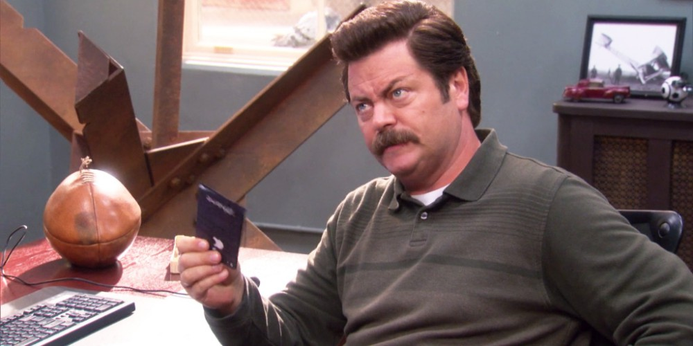 Ron Swanson holding Tom's paper iPhone