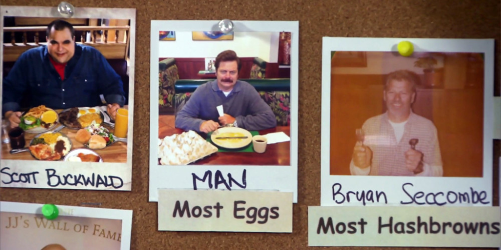 Ron Swanson tears down a picture taken of him at JJ's Diner picture2