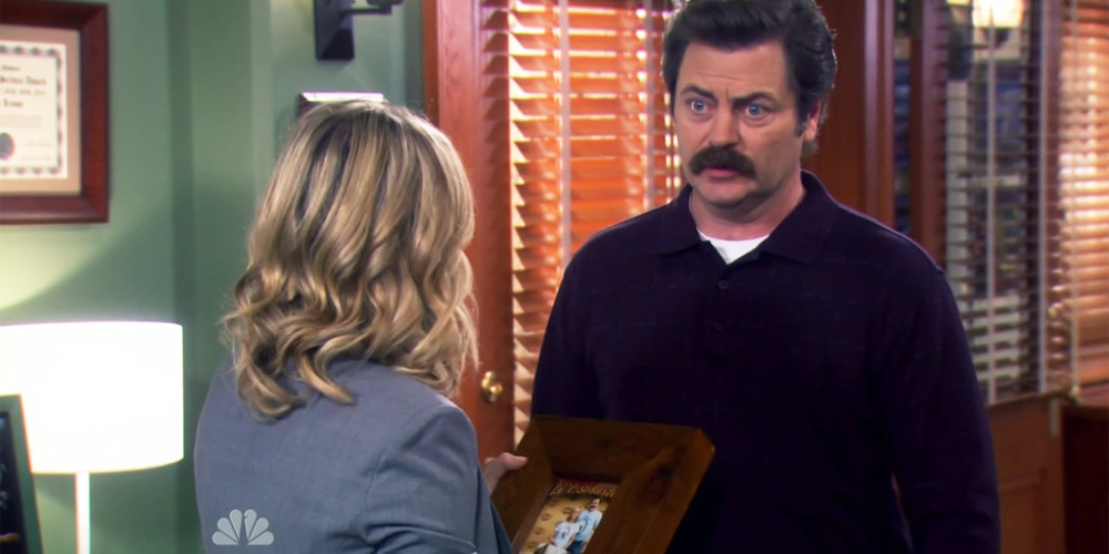 Ron Swanson made Leslie a picture frame from the nurse's door