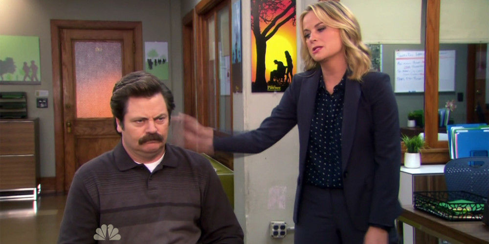 Leslie Knope tortures Ron Swanson picture1