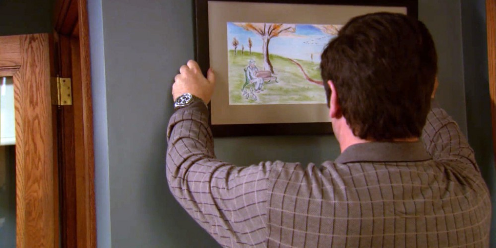 Hanging up the Spirit of Pawnee painting.