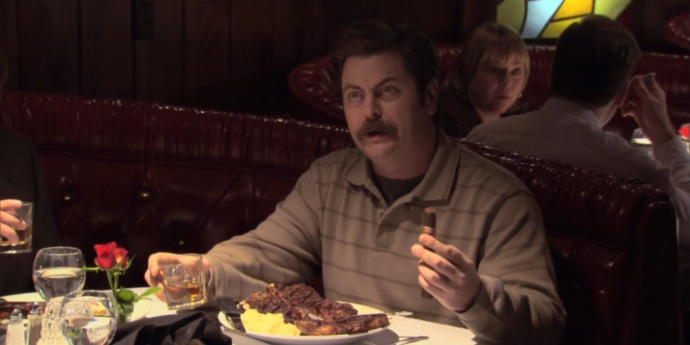 Ron Swanson with turf and turf dinner, whiskey, and a cigar.