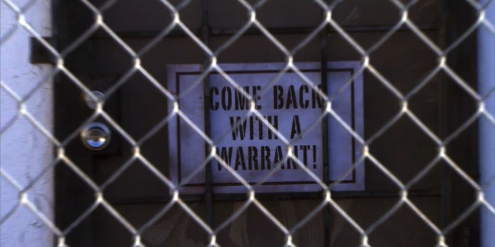 Sign: Come back with a warrant.