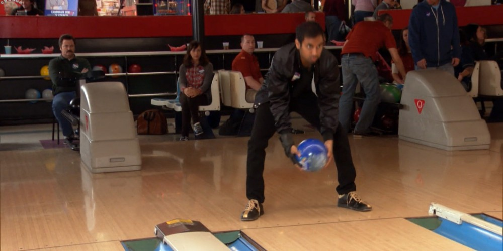 Tom bowls underhanded, between the legs