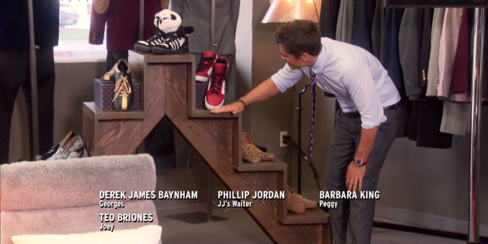 Tom Haverford ended up using Chris' flight of stairs as a shoe rack picture2