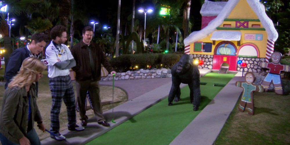 Ron Swanson does not quite understand the art of mini golf course obstacles