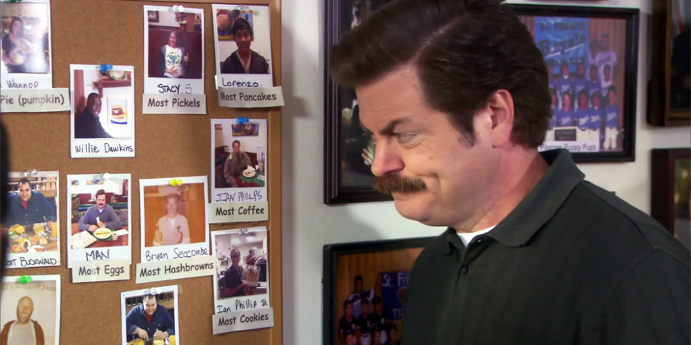 Ron Swanson tears down a picture taken of him at JJ's Diner